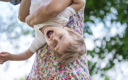 Toddler boy and his mom. Having fun in summer park Stock Photography