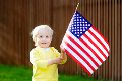 Toddler boy holding american flag Royalty Free Stock Photo