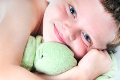 Toddler boy hugging toy. Young toddler boy hugging lovey toy Stock Photo