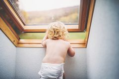 Free Toddler Boy In A Dangerous Situation At Home. Royalty Free Stock Photos - 111567758