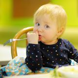 Toddler boy at the indoors cafe Royalty Free Stock Photography