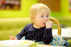 Toddler boy at the indoors cafe Stock Photography