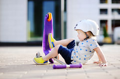 Toddler boy learning to ride scooter Royalty Free Stock Photography