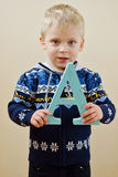 Toddler boy  with letter A Stock Images