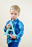 Toddler  boy with   letter A Stock Photos