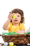 Toddler boy looking at yellow egg Royalty Free Stock Photos