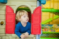 Toddler boy looks out of the house Royalty Free Stock Photos