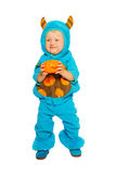 Toddler boy in monster costume with pumpkin Royalty Free Stock Image