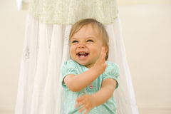 Toddler boy (15-18 months) laughing by mother, close-up Royalty Free Stock Photo