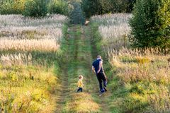 Toddler boy in nature with father, playing time royalty free stock photos