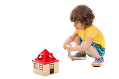 Toddler boy opening toy house Royalty Free Stock Photo