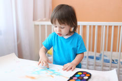 Toddler boy painting with fingers Royalty Free Stock Image
