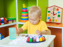 Toddler boy painting Stock Images