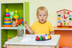 Toddler boy painting Stock Photos