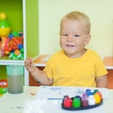 Toddler boy painting Royalty Free Stock Image