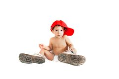 Toddler boy in parent's boots Royalty Free Stock Image