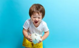 Toddler boy with a piggy bank Royalty Free Stock Images