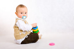 The toddler boy play on floor Royalty Free Stock Photo