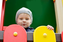 Toddler boy on the playground Stock Images