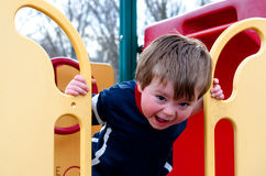 Toddler boy on the playground stock photos