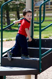 Toddler boy on playground steps Stock Images