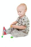 Toddler boy playing Royalty Free Stock Photos