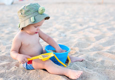 Toddler boy playing on the beach Royalty Free Stock Photos