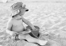 Toddler boy playing on the beach Royalty Free Stock Images