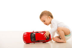 Toddler boy playing with big car Stock Photos