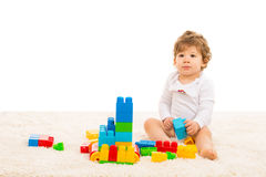 Toddler boy playing with building blocks Stock Photo