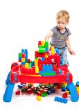 Toddler boy playing with building blocks Stock Photos