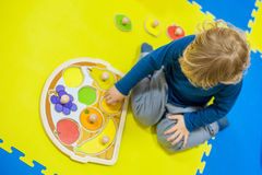Toddler boy playing in developing the game Royalty Free Stock Photos
