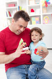 Toddler boy playing with his father Royalty Free Stock Photos