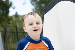 Toddler Boy Playing at Neighborhood Splash Pad & Pool Slide stock photos