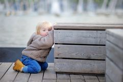 Toddler boy playing outdoors Stock Photography