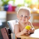 Toddler boy playing outdoors Stock Photos