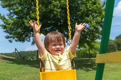 Toddler boy playing at a playground Royalty Free Stock Image