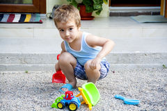 Toddler boy playing in the sand Stock Image