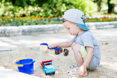 Toddler boy playing in the sand Stock Photography
