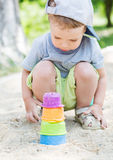 Toddler boy playing in the sand Stock Photo