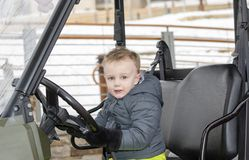 Toddler Boy Playing in a Snow Jeep During the Winter. At a Colorado Ski Rsort Royalty Free Stock Images