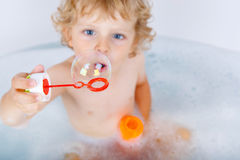 Toddler boy playing with soap bubbles in bathtub Royalty Free Stock Photos