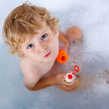 Toddler boy playing with soap bubbles in bathtub Royalty Free Stock Photography