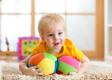 Toddler boy playing with toys indoor Stock Image