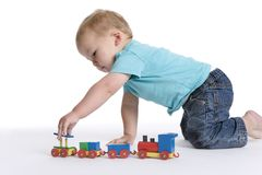 Toddler boy playing with train Royalty Free Stock Images