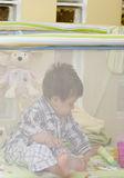 Toddler boy in playpen  Stock Photo