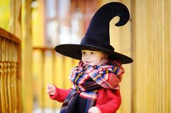 Toddler boy in pointed hat playing outdoors Stock Images