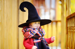 Toddler boy in pointed hat playing outdoors Royalty Free Stock Images