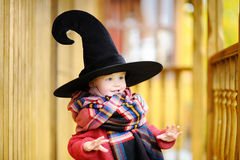 Toddler boy in pointed hat playing outdoors Royalty Free Stock Photography