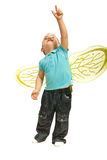 Toddler boy pointing up. Toddler boy with bee wings pointing up isolated on white background Stock Photo
